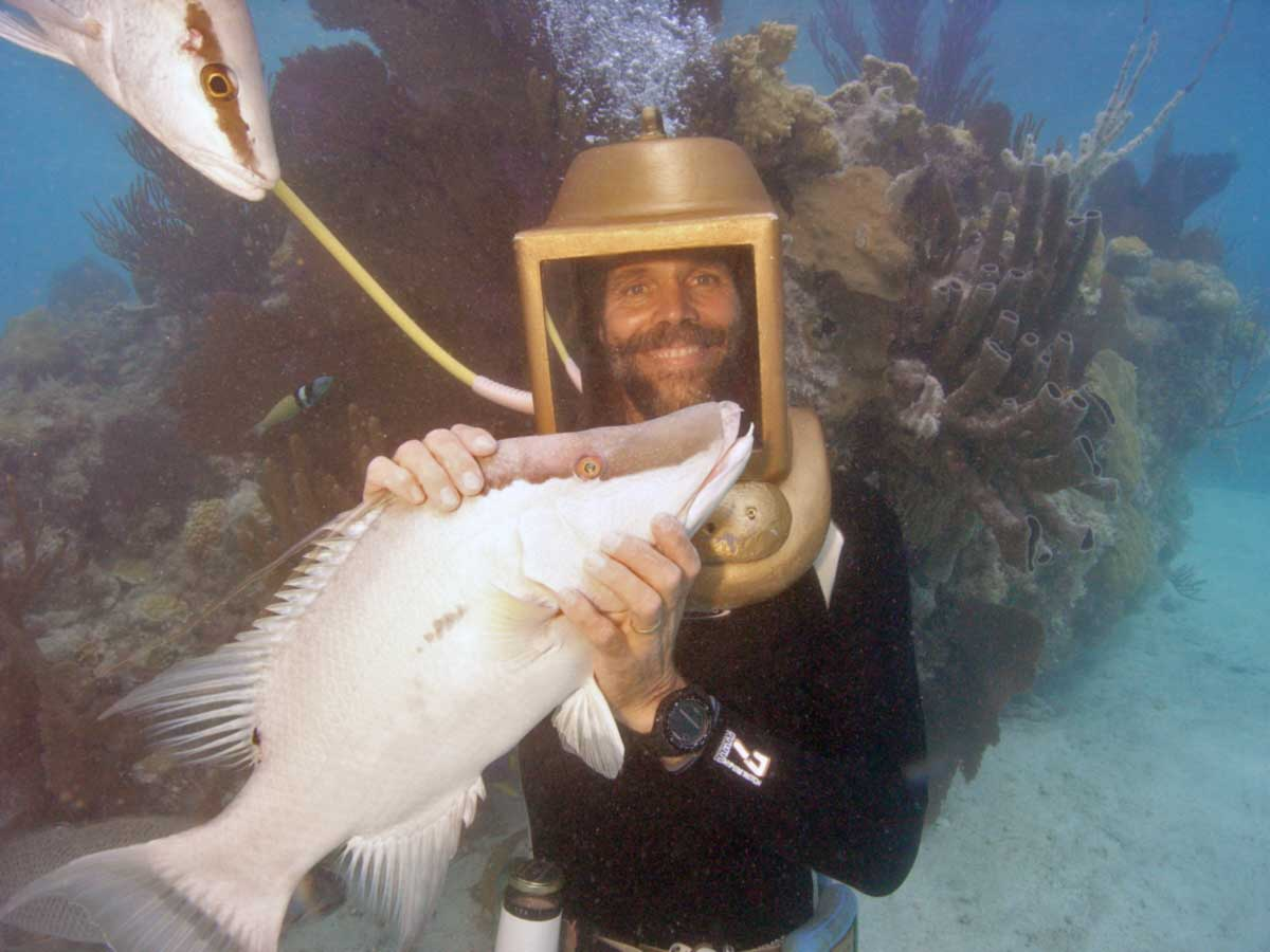 Greg Hartley holding Charles the hogfish in Bermuda