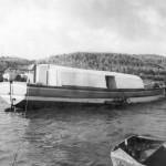 Old photo of boat making a break water.