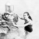 Cuban Martica standing in water posing with diving helmet in Bermuda