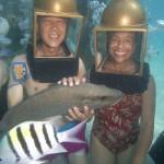 Helmet Divers in Bermuda holding a grey snapper
