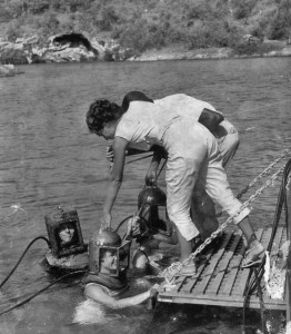 Photo of Bermuda helmet divers returning to the boat in the early days