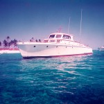 65 ft huckins yacht at Rose Island in the Bahamas