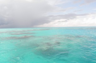 View from helmet diving vessel as it approaches the dive site with rain a little ways off.