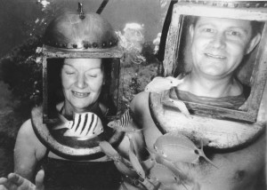 Early helmet diving couple.