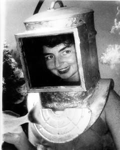 Lady helmet diver late 1940's feeding George the Grunt