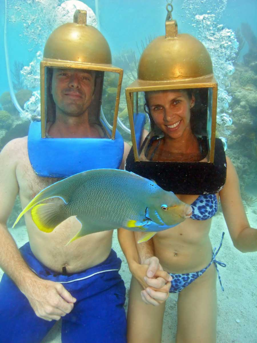 Couple, with angelfish up close, helmet diving in Bermuda