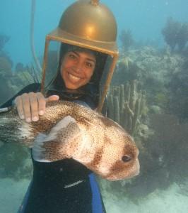 Helmet diver in Bermuda holding ET the porcupine puffer.